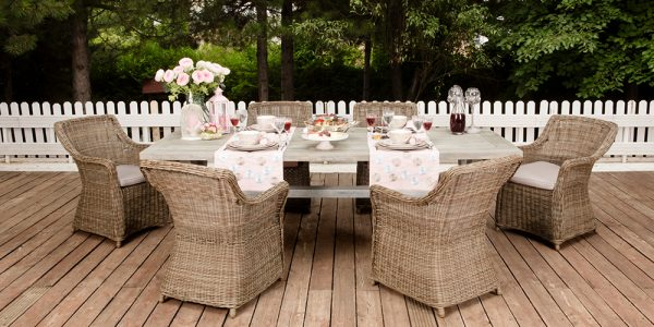 backyard deck with table seating six
