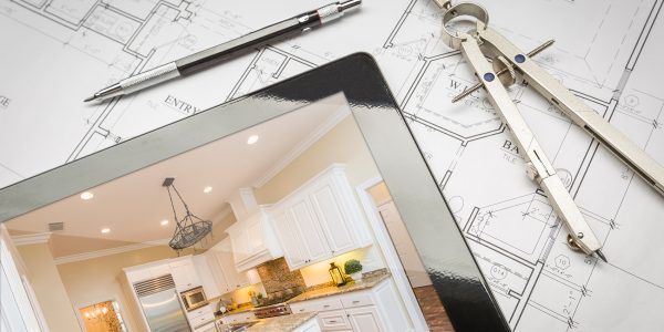 ipad with compass and floor plans for home addition