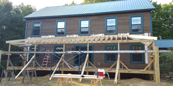 farmers porch addition in progress by lighthouse contracting group