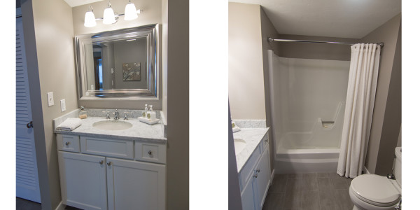 white cabinets marble countertop grey tile floor fiberglass tub bathroom remodel
