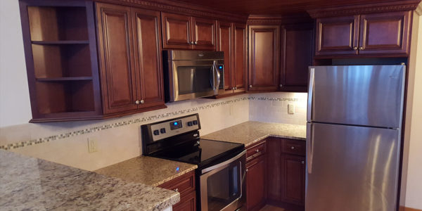 custom kitchen remodel cabinets, tile backsplash and flooring lighthouse contracting