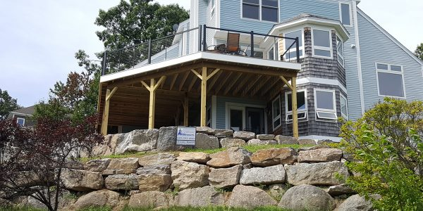 custom azek pvc deck with cable railings on lake winnipesaukee home