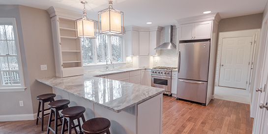 white cabinets marble countertops chrome light fixtures kitchen