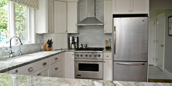 white kitchen cabinets with stainless steel appliances gilford nh