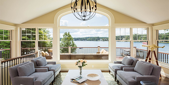 living room with a panoramic lake view