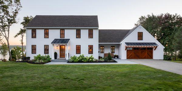 residential-renovation-black-windows-white-siding-wood-garage-door-nh