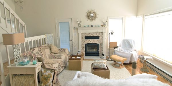 cottage chic lake house condo living room with fireplace