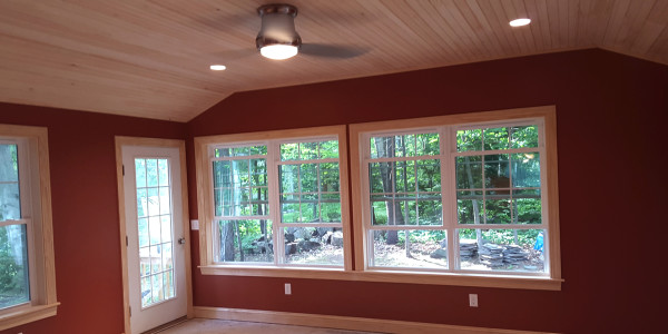 custom home addition with wood ceiling