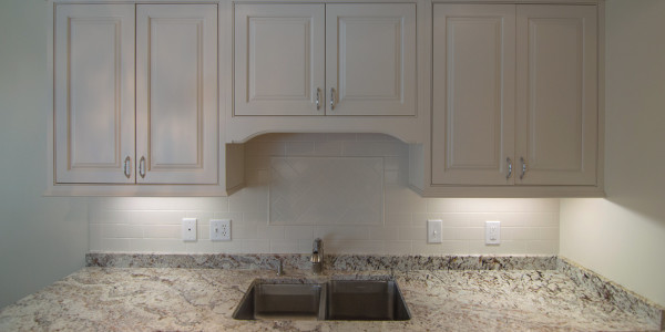 marble countertops with white cabinets lighthouse contracting group