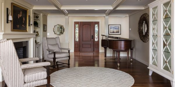 white coffered ceiling music room with fireplace and wood floors