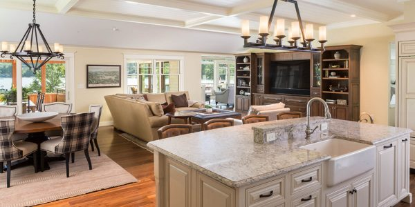 open concept white coffered ceiling kitchen island with farmhouse sink oil bronzed light fixtures