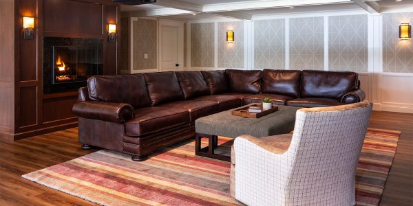 custom designed entertainment room in basement with leather sectional