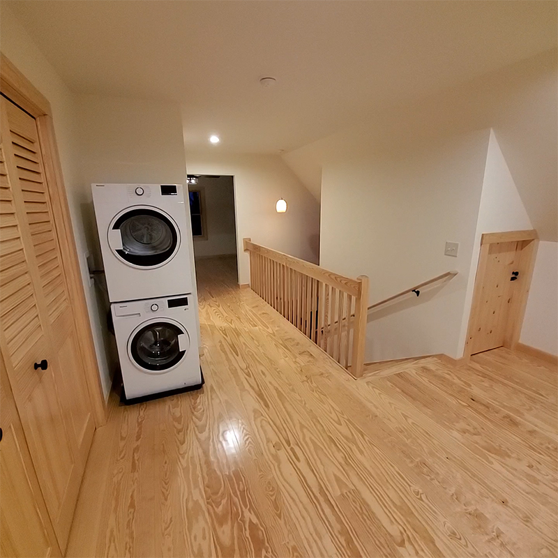 stackable white washer and dryer upstairs hallway
