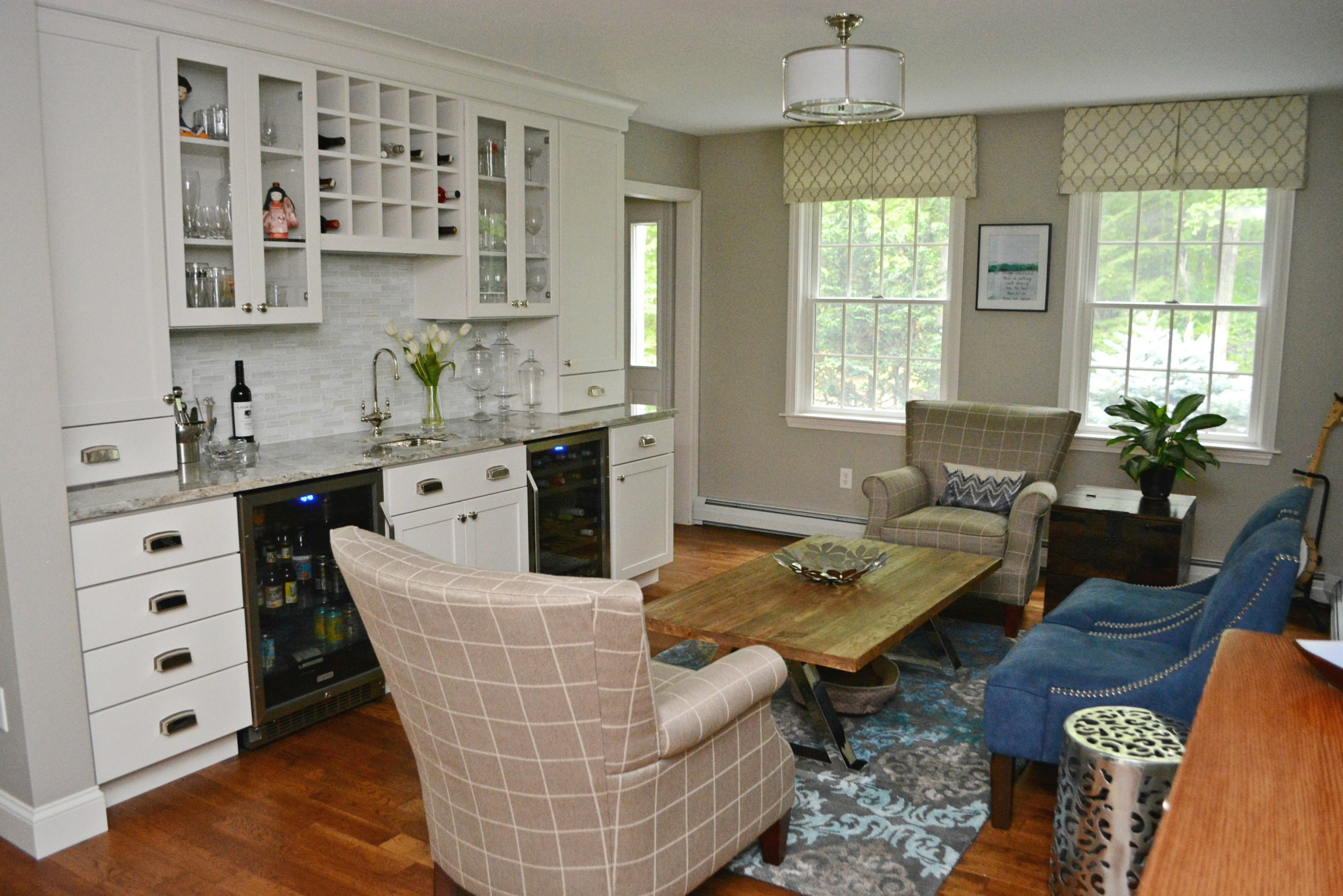 Gray white color scheme with warm wood floors