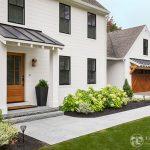 black and white farmhouse exterior pella windows