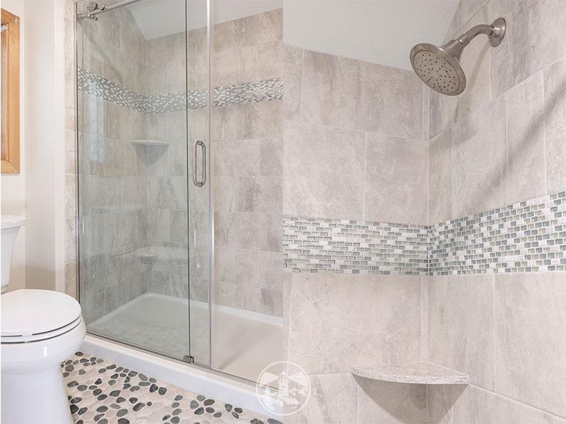frameless sliding shower door condo bathroom remodel